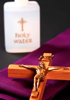 A crucifix and holy water are among the religious items used in the rite of exorcism.