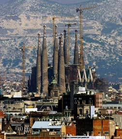 The spires of Gaudi's La Sagrada Familia Basilica are seen in a skyline view of Barcelona.