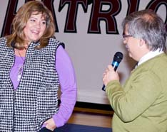 Chastity educator Pam Stenzel is thanked by John Paul II High School Principal Bill Tonita for bringing her straight talk to his students.