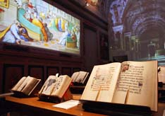 A copy of the Borgianus Latinus, right, a missal for Christmas made for Pope Alexander VI, is displayed in a new exhibit on the Vatican Library.