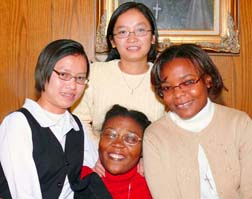 Sisters of Providence and novices, Rosa Sen Nguyen, left, Hong Nga Nguyen, top, Mimose Jean, right, and Sandrine Tselikeme, centre are visiting Canada as part of their formation.