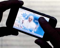 An image of Pope Benedict is seen on a Vatican website as displayed on an Apple iPod touch. The site features iPhone and Facebook applications aimed at reaching the youth.