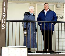 Sr. Mary Clare Stack of Catholic Social Services and Cam MacDonald of Edmonton Inner City Housing Society were among the volunteers bringing welcome baskets to the new tenants of Harry Holt Place.