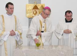 Archbishop Richard Smith anoints the new altar with holy chrism.