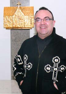 Newman College dean, Fr. Stefano Penna is proud of the college's new Cardinal Newman Chapel.