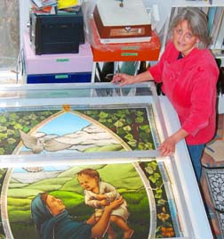 Stained-glass artist Deborah Coombs works on a window for a chapel in Nashville, Tenn.