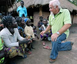 A missionary talks with villagers in a refugee camp in Southern Sudan.