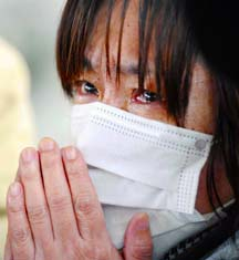 A woman weeps after being told of the death of relatives at an evacuation centre in Kesennuma, Japan, March 15.