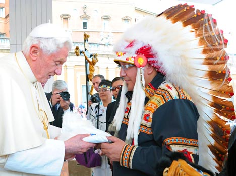 Pope Benedict accepts a gift from  Manitoba Keewatinowi Okimakanak (MKO) Grand Chief David Harper at the end of his weekly audience in St. Peter's Square at the Vatican March 23.