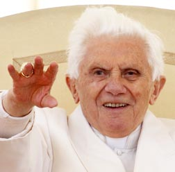 Pope Benedict waves as he leads his general audience in St. Peter's Square April 13.