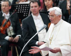 Pope Benedict gives a short talk after listening to a concert in his honour in Paul VI Hall at the Vatican May 5.