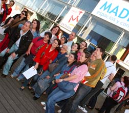 People pose for a group photo, gather for a Mass and concert May 8 at an arena in Madrid, marking 100 days until the start of  World Youth Day 2011.