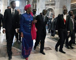 Zimbabwean President Robert Mugabe, centre, and his wife Grace leave St. Peter's Basilica after paying their respects at the casket of Blessed Pope John Paul II at the Vatican May 1.