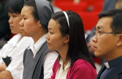 People attend an international conference on AIDS at the Vatican May 27.