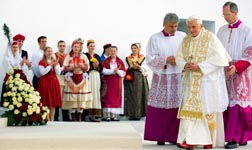 Pope Benedict walks near young people in traditional clothing during a prayer vigil with some 50,000 people in Ban Josip Jelacic Square in Zagreb, Croatia, June 4.