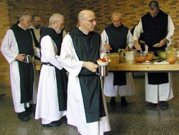 Trappist monks at the Abbey of Gethsemani prepare to eat lunch in their dining hall in Trappist, Ky. Fifty men live in the community.