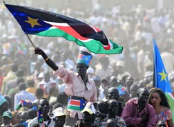 A man waves South Sudan's national flag as he attends the Independence Day celebrations in Juba July 9. Hundreds of thousands of people celebrated independence after decades of civil war.