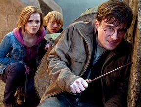 "Daniel Radcliffe, front, Emma Watson and Rupert Grint star in a scene from the movie ""Harry Potter and the Deathly Hallows — Part 2."""