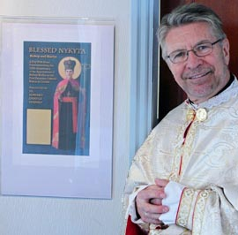 Fr. Evanko stands by the poster for his latest one-man show Blessed Nykyta: Bishop and Martyr. The play tells the story of Nykyta Budka who died in a gulag in the USSR.
