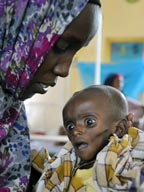 Asio Dagene Osman cares for her severely malnourished son, Minhaji Gedi Farah, at a refugee camp in northeastern Kenya.