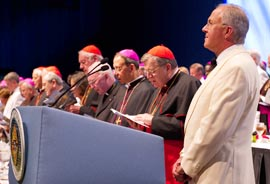 Carl Anderson, supreme knight of the Knights of Columbus, stands with cardinals, archbishops and bishops during the 129th annual supreme convention in Denver.