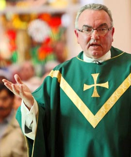 Father Edward Sheridan delivers the homily during Mass at St. Rosalie Church in Hampton Bays, N.Y.