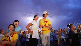 Lightning flashes behind pilgrims as they attend the World Youth Day prayer vigil led by Pope Benedict XVI at the Cuatro Vientos airfield in Madrid Aug. 20.
