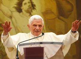 Pope Benedict greets the crowd after leading the Angelus from a balcony of his summer residence Aug. 28.