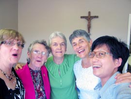 Centre volunteers Lorie McMillan, left, Gertrude Parenteau, Jeanne McCusker, Ingrid Brodeur and Jenny Lo share a moment of joy.