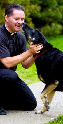 Fr. James Mallen enjoys his dog Monsi