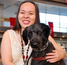 Quyn Le sits with her dog Nugget at Simon Fraser University.