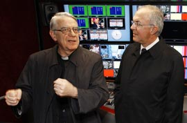 Fr. Federico Lombardi, left, talks with Carl Anderson, supreme knight of the Knights of Columbus, in the Vatican's high-definition TV studio.