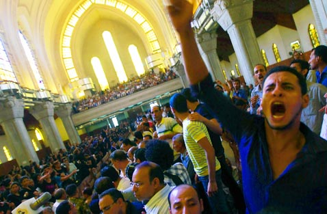 A man chants pro-Christian slogans during a funeral at Abassaiya Orthodox Cathedral in Cairo Oct. 10. At least 26 people, mostly Christians, were killed Oct. 9 when troops broke up a peaceful protest against an attack on a church in southern Egypt.