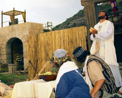 Jesus, seen saying grace with his disciples, shared meals with many.