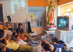 People pack a room at the St. Juan Diego Migrant House, a shelter and sanctuary for travelers, in a suburb of Mexico City.