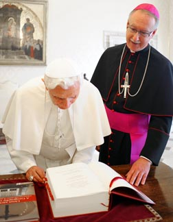 Archbishop Richard Smith presents the new Canadian English version of the Roman Missal to Pope Benedict in Rome Nov. 7.