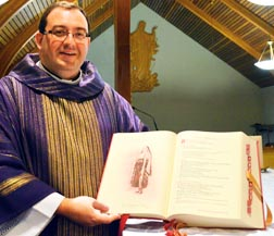 Fr. Paul Kavanagh, director of liturgy for the Edmonton Archdiocese, displays the new Roman Missal, which will be implemented across Canada on Nov. 27, the first Sunday of Advent.