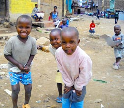 Children play in a street in Nairobi's Kariobangi slum. People live amid open sewers, piles of garbage, intermittent electricity service.
