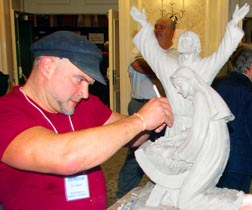 Sculptor Tim Schmalz works on his nativity at the friends of the Crèche International Convention in Toronto.
