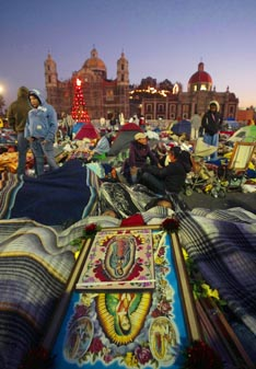 Images of Our Lady of Guadalupe are seen as Mexican Pilgrims gather outside the Basilica of Our Lady of Guadalupe in Mexico City for Our Lady's feast on Dec. 12.