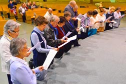 Fifteen parishioners of St. Theresa Parish consecrated themselves to the Blessed Virgin.