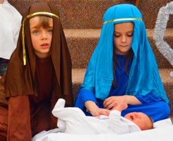 Kaleb Hedley (Joseph) and Sydney Grono (Mary) care for baby Jesus (Catherine Landry).