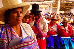 Women at a February 2010 meeting in Cruz de Mayo, Peru, listen as local and government leaders discuss water rights for their community.