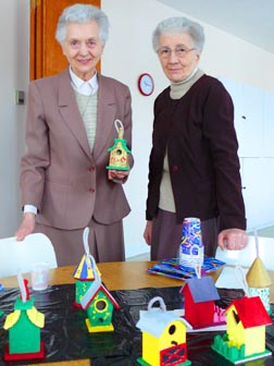 Sr. June Schlereth, left, and Sr. Teresa Schlereth, Franciscan Sisters of the Atonement, led a recent prayer session that involved painting birdhouses.