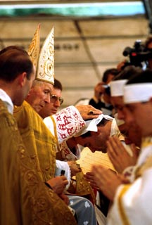 Archbishop Marcel Lefebvre, a leading dissident from Vatican II teachings, presides at the 1988 ordinations of four bishops in Econe Switzerland. Lefebvre and his four bishops were excommunicated for participating in the ordination that had been forbidden by Pope John Paul II.