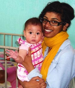 Roxanne Dias says spending 14 days holding babies afflicted with HIV/AIDS changed her life.
