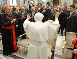Pope Benedict waves during a meeting with members of the Pontifical Academy for Life at the Vatican Feb. 25.
