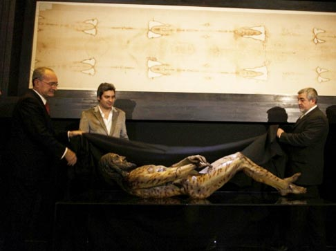 A copy of the original Shroud of Turin is displayed above a statue of Christ's body at an exhibition at the Cathedral of the Incarnation in Malaga, Spain, Feb. 20. The shroud, believed to be the burial cloth of Jesus, bears the image of an apparently crucified man. The exhibition will run from Feb. 21 until June 1.