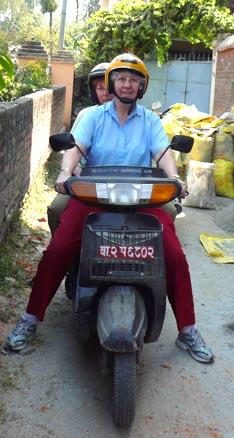 Mary Martin steers through Nepalese streets on her scooter called Precious.