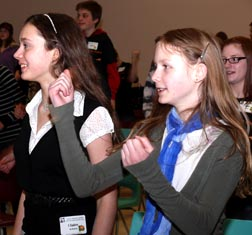 Claire McMahon, left, and Gabrielle Kramer dared to move at the youth rally.
